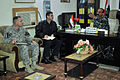 Iraqi Police Col. Hadi Hashish, background, speaks to U.S. Army Lt. Col. Andy Poznick during a meeting to discuss security and coordination concerns in the Basrah province at the Shat Al Arab District 110313-A-WO967-005.jpg