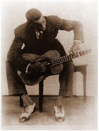 Isaac Oviedo - Oviedo playing the tres, c. 1930.