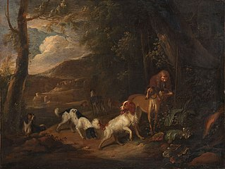 Hunter with hounds at the edge of a wood