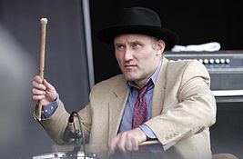 Jah Wobble playing drums.jpg