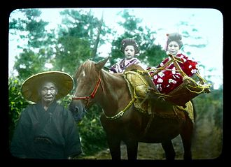 Packhorse - Japanese pack horse (ni-uma or konida uma) carrying two girls as passengers, circa 1900-1929.