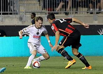 Elliott Ward - Ward defending against Philadelphia Union midfielder Jimmy McLaughlin in a 2015 international friendly