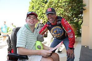 Kyle Petty Charity Ride Across America - Kyle Petty with Victory Junction camper on 2016 Ride in Biloxi, Mississippi.