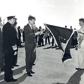 363d Intelligence, Surveillance and Reconnaissance Wing - President Kennedy presents AFOUA to the 363 TRW in 1962 in recognition of the unit's actions associated with the Cuban Missile Crisis.