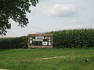 Kent, Illinois - Sign leading into Kent, Illinois, which notes the population of both people and dogs.