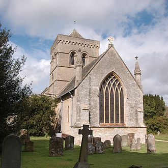 Kirtlington - St Mary the Virgin parish church from the east, showing the intersecting tracery of the chancel's 14th century east window