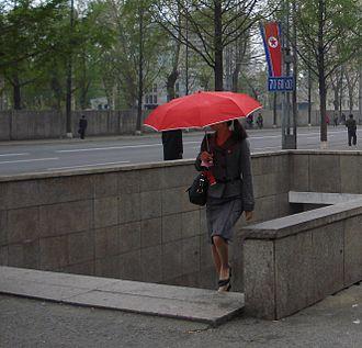Demographics of North Korea - Young Korean woman walking in Pyongyang