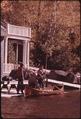LOADING AN ADIRONDACK GUIDE BOAT ON LOWER AUSABLE LAKE - NARA - 554661.tif