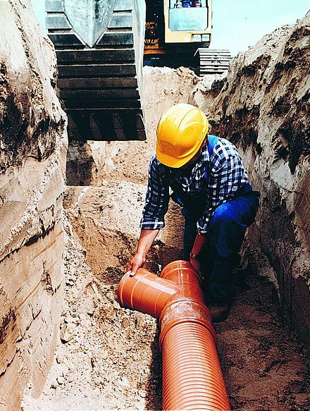 PVC is used extensively in sewage pipes due to its low cost, chemical resistance and ease of jointing Laying sewer hi res (2).jpg
