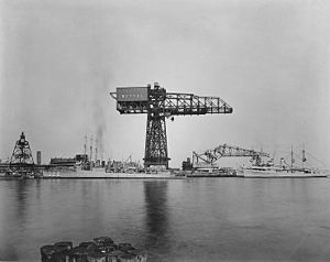 "Philadelphia Naval Shipyard - The ""League Island Crane"" with the destroyer USS ''Lamson'' in the foreground."