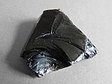 A piece of volcanic obsidian glass