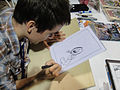 Long Beach Comic & Horror Con 2011 - Chris Houghton sketches some Reed Gunther goodness (6301179165).jpg