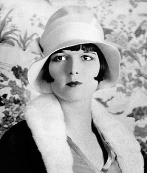 1920s in Western fashion - Actress Louise Brooks in 1927, wearing bobbed hair under a cloche hat