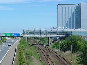 Lufthavnen Station - The Metro structure bridges the motorway and railway line.