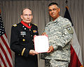 Maj. Gen. Manuel A. Rodriguez VII, Commander of the Texas State Guard, presents Col. Stephen B. Springer with the Lone Star Distinguished Service Medal.jpg