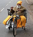 Man in Wheelchair - Hastings Road - Allahabad - Uttar Pradesh - India (12566778265).jpg
