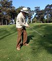 Man with pitching wedge.jpg