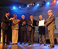 Manish Tewari presenting the Life Time Achievement Award to the Polish Film Director, Mr. Krzystof Zanussiat, at the inaugural ceremony of the 43rd International Film Festival of India (IFFI-2012), in Panaji.jpg