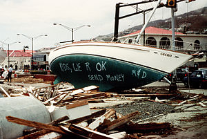 Hurricane Marilyn - Beached sailboat on St. Thomas used as a billboard