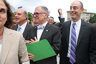 Obergefell v. Hodges - Outside the Supreme Court on the morning of June 26, 2015, James Obergefell (foreground, center) and attorney Al Gerhardstein (foreground, left) react to its historic decision.