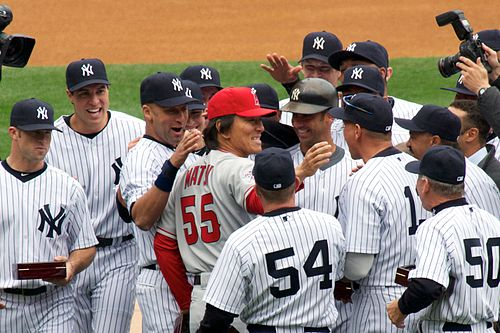 Matsui greeted by his former teammates during the Yankees' 2010 home opener, as he receives his 2009 World Series ring Matsui greeted by Yankees 4-13-10.jpg
