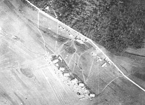 11th Aero Squadron - Maulan Aerodrome, France.  Note the six tent and frame hangars at the airfield, with the squadrons' DH-4s lined up in front.   Trails made by vehicles in the field show the routes taken to the station area and personnel tents along the road to Maulan