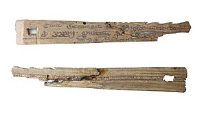 Tally stick - Medieval English split tally stick (front and reverse view). The stick is notched and inscribed to record a debt owed to the rural dean of Preston Candover, Hampshire, of a tithe of 20d each on 32 sheep, amounting to a total sum of £2 13s. 4d.