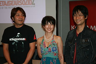 Metal Gear Solid 4: Guns of the Patriots - From the left to right: Kenichiro Imaizumi (producer), Yumi Kikuchi (Raging Raven character of The Beauty and the Beast Unit, voice and motion capture actress), Hideo Kojima (producer, director, writer) at the Games Convention 2007.