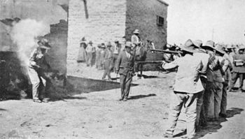 1916 photograph of an execution by firing squa...