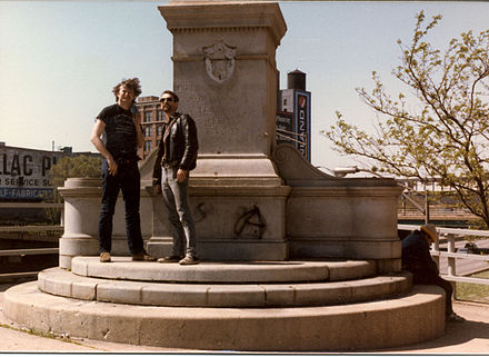 Two activists at the statue-less pedestal of the police monument on the 100th anniversary of the Haymarket affair in May 1986; the pedestal has since been removed. - Haymarket affair
