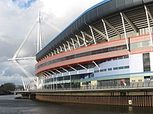 Exterior view of the stadium from across a river