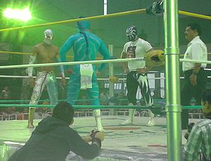 Místico II - Místico (left) in the ring with Volador Jr. (center) and La Sombra (right) in May 2013
