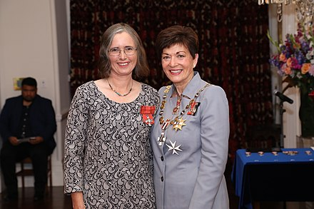 Mathers (left) in 2019, after her investiture as a Member of the New Zealand Order of Merit by the governor-general, Dame Patsy Reddy Mojo Mathers MNZM investiture.jpg