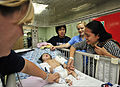 Mokodompit Nurain, right, checks on her four-month-old daughter who had surgery to fix her cleft lip aboard Military Sealift Command hospital ship USNS Mercy (T-AH 19) in North Sulawesi, Indonesia, June 2, 2012 120602-O-ZZ999-005.jpg