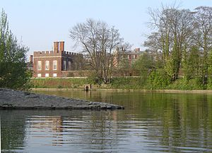 Longford River - One outlet of the Longford River is visible on the bank of The Thames at the Water Gallery at Hampton Court, just above the junction with the River Mole.  Viewed from the Mole across the Thames to Hampton Court