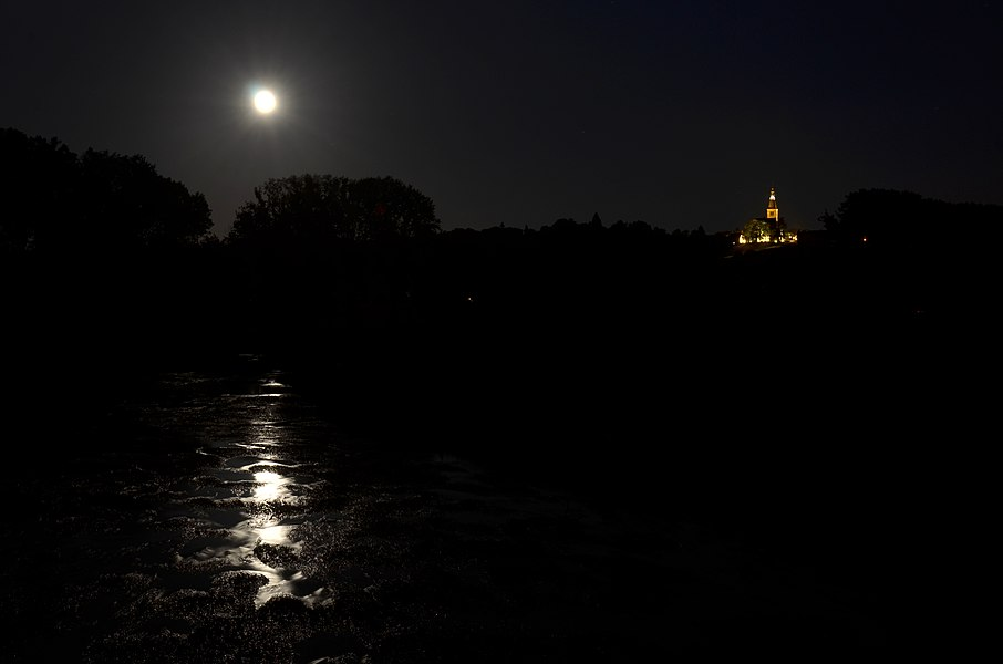 The Semois river at Martué (southern Belgium) with the Florenville church illuminated