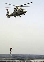 Moroccan HH-65A Dolphin helicopter. dropping a search and rescue swimmer.jpg