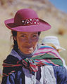 Mother with a rose pink hat and child Peru.jpg