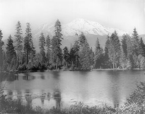 Mount Shasta overlooking a lake surrounded by trees, Siskiyou County, ca.1900-1940 (CHS-5075).jpg