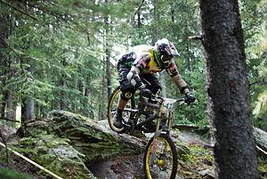mountain bike in downhill race in forest ski trail