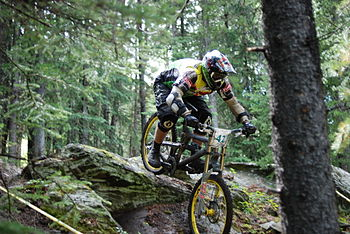 mountain bike in downhill race in forest ski trail
