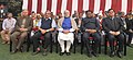 Narendra Modi and the Union Minister for Defence, Shri Manohar Parrikar with the Tribal Guests and Tableaux Artists, in New Delhi. The Union Minister for Tribal Affairs.jpg
