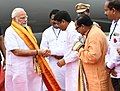 Narendra Modi being welcomed by the Union Minister for Tribal Affairs, Shri Jual Oram and the Union Minister for Petroleum & Natural Gas and Skill Development & Entrepreneurship, Shri Dharmendra Pradhan, on his arrival.JPG