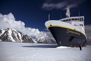 Transport in Antarctica - A tour boat in fast ice near the coast