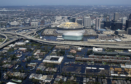 An aerial view from a United States Navy helicopter showing floodwaters around the Louisiana Superdome (stadium) and surrounding area (2005) Navy-FloodedNewOrleans.jpg