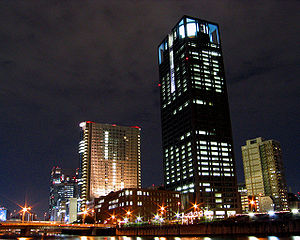 Kansai Electric Power Company - The top of the building is lit up like a light bulb at night