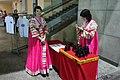 North Korea - Binoculars and souvenirs sellers (5015832024).jpg