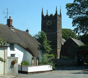 Thatched cottage and parish church at Northlew