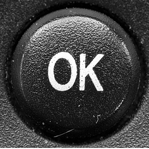 OK - An OK button on a remote control