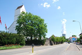 Obergösgen church and in the background the cooling tower of the Gösgen nuclear power plant